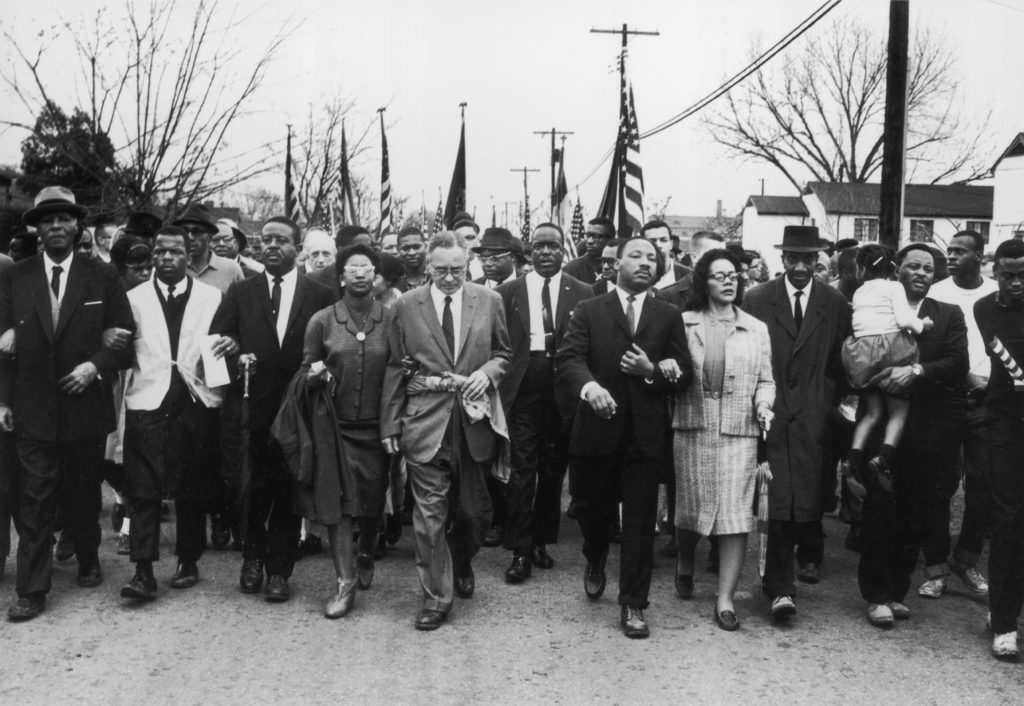 American civil rights leader Martin Luther King and Coretta Scott King lead a voting rights march from Selma, Alabama, to the state capital in Montgomery.