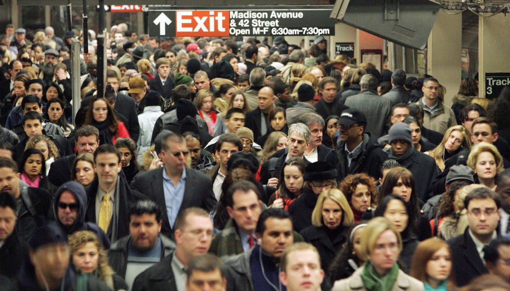 Commuters pass through Grand Central Terminal during morning rush hour December 19, 2005 in New York City.