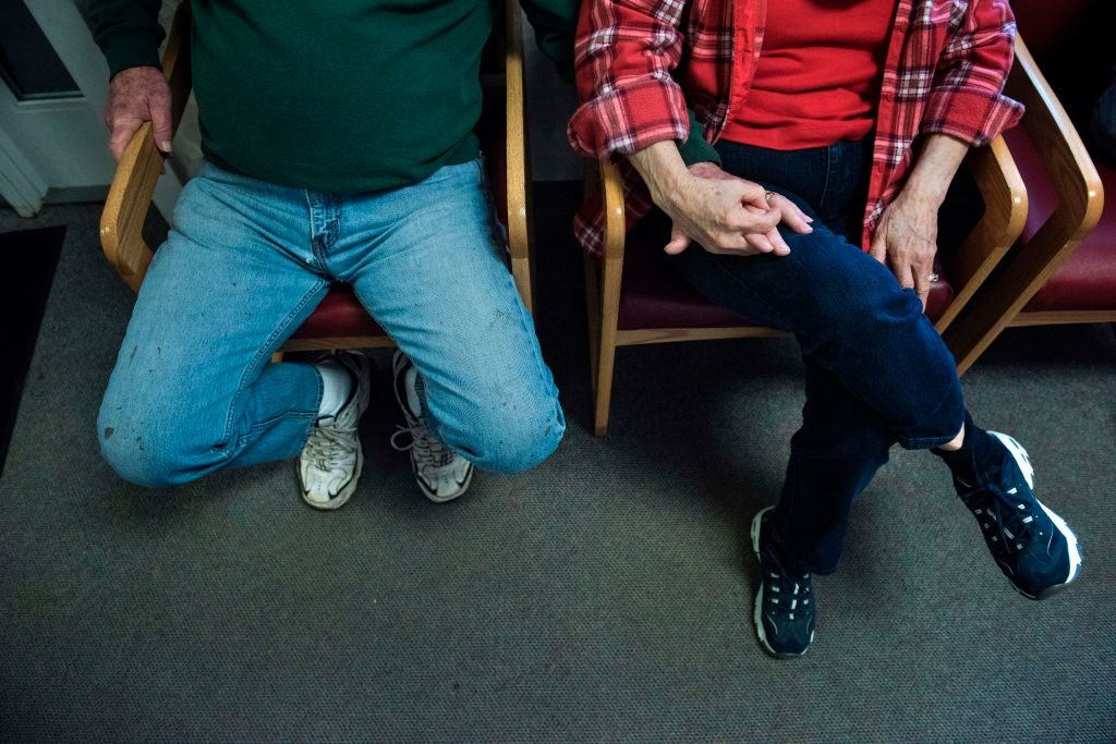 A couple waits for an appointment at the Community Health Center of Northeast Wetzel County in Burton, West Virginia.