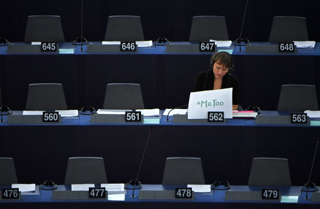 Swedish MEP Linnéa Engström sits with a placard on her desk during a debate about fighting sexual harassment and abuse in the European Union at the European Parliament in Strasbourg, France, on October 25, 2017.
