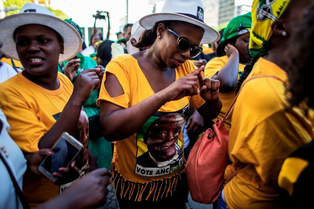 Supporters of the South Africa's new President Cyril Ramaphosa sing and dance his praise  in Cape Town after Members of Parliament voted him into office.